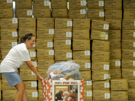 Terri Stein, a volunteer with the York County Toys for Tots drags a box of stuffed animal out of a storage area located in Springettsbury Township on Saturday, July 25, 2015. The organization needed to move their toys to a new location in West Manchester Township when the space they were using was sold.  Jason Plotkin - Daily Record/Sunday News