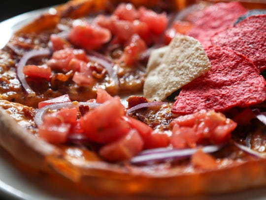 The Pimita from The Cafe is made with homemade Pimento cheese, diced tomatoes, bacon and red onions, with an oversized pita bread for its crust.