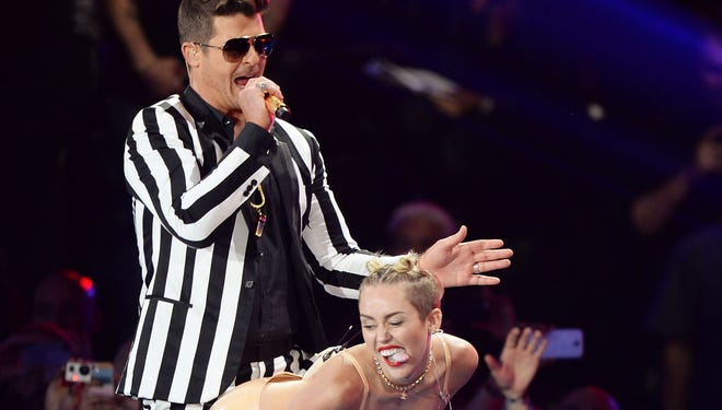 Robin Thicke and Miley Cyrus at last year's MTV VMAs. Who could ever forget that show?