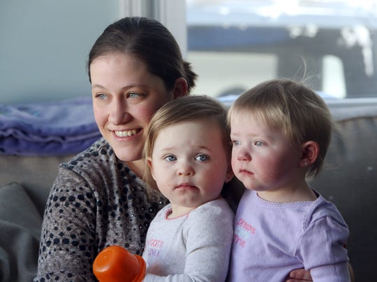 Melanie Dumpert with her twin daughters 17-month-old Evelyn, l, and Vivian. Vivian is a twin girl born with a congenital heart defect. While doctors told her parents she would likely die before being born, sheÕs continued to beat the odds through several open heart surgeries.  February 10, 2017, Landing, NJ.
