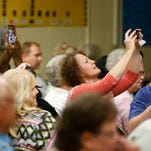Parents take photos of their student during a graduation ceremony for fifth-grade students at Sherwood Elementary on the last day of school Wednesday, May 20, 2015.