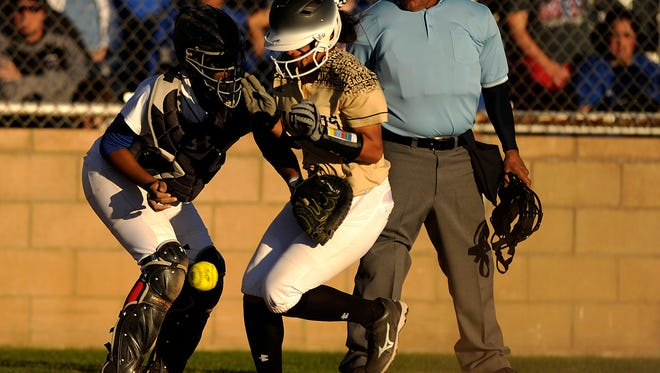 Abilene High's Jaiden Franklin (5) scores ahead of the throw to Cooper catcher Symone Gary (24) during the top of the fourth inning of the Lady Eagles' 13-1 win in the Abilene Icebreaker softball tournament on Friday, Feb. 24, 2017, at Cooper High School.