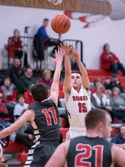Bucyrus' Ryan Evans shoots from the outside.