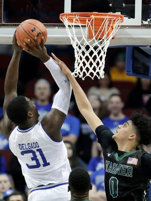 Seton Hall center Angel Delgado (31) goes up for a shot against Wagner forward Nigel Jackson (0).
