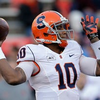 Syracuse quarterback Terrel Hunt (10) runs with the ball during the second quarter.