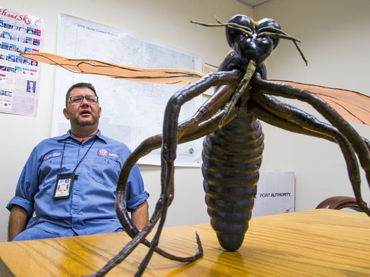 David Guerrieri, a Maricopa County Environmental Services vector-control supervisor, speaks to the challenges of protecting the public from mosquitoes, some of which could carry the Zika virus. He spoke Thursday, May 19, 2016, with a model of a mosquito nearby. The fear of the Zika virus, which is spread by mosquitoes, has spurred the effort for local mosquito control.