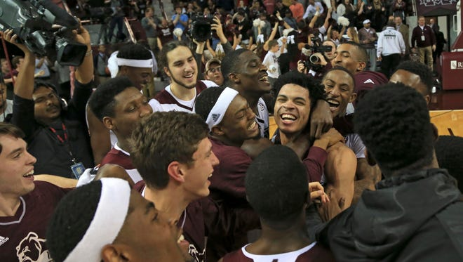 Mississippi State players celebrate with Quinndary Weatherspoon, who hit a 3-pointer at the buzzer to beat Vanderbilt 75-74 on Feb. 16, 2016.