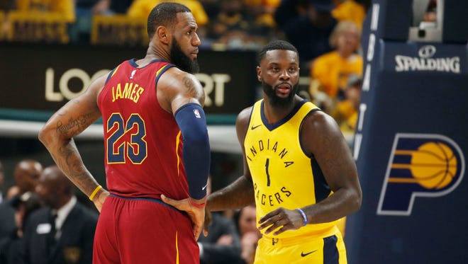 Cleveland Cavaliers forward LeBron James (23) is guarded by Indiana Pacers guard Lance Stephenson (1) during the first quarter in game three of the first round of the 2018 NBA Playoffs at Bankers Life Fieldhouse.