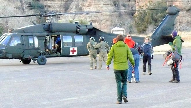 The New Mexico Army National Guard and the U.S. Customs Border Patrol helped evacuate two groups of stranded hikers from the West Fork of the Gila River on Christmas Day.