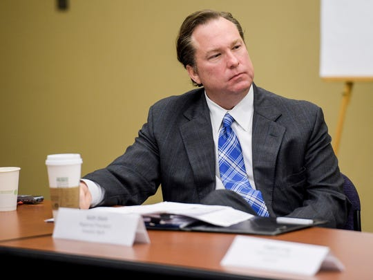 Keith Short, regional president of Investors Bank, listens to discussions at the Daily Advertiser in Lafayette, La., Tuesday, Jan. 13, 2015.