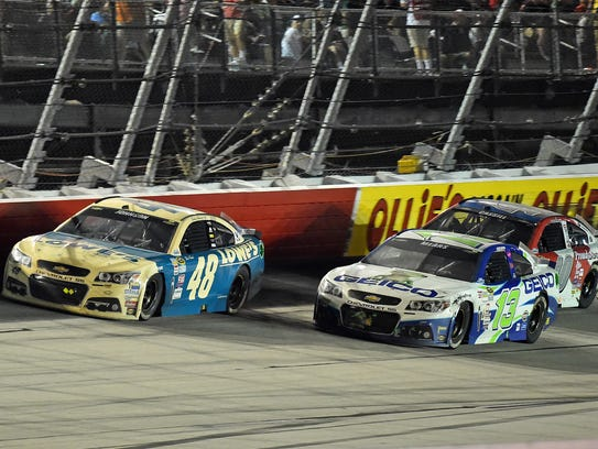 Casey Mears (13) races Jimmie Johnson (48) during the