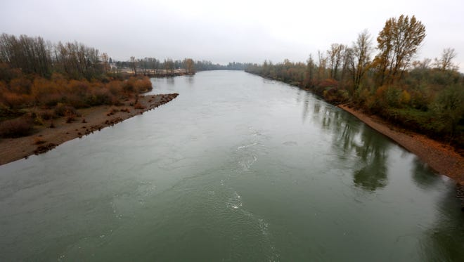 The Willamette River flows below the River Road S bridge, Wednesday, December 2, 2015, near Independence, Ore.
