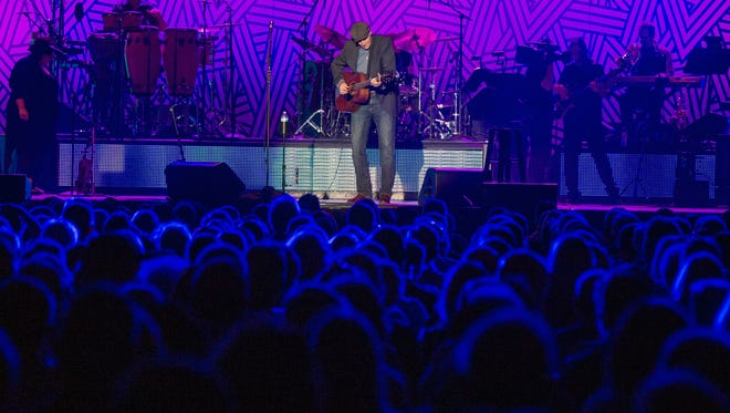 James Taylor performs at the Floyd L. Maines Veterans Memorial Arena in July.