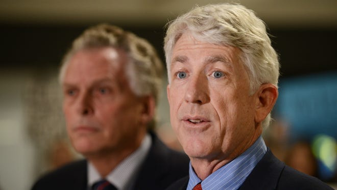 Virginia Attorney General Mark Herring, D, shown here with Gov. Terry McAuliffe, on Thursday announced new federal funding to further eliminate the backlog of untested rape kits.