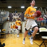 Kickapoo High School players take the court prior to the start of the Chiefs' Class 5 District 11 playoff game against Parkview High School at Kickapoo High School in Springfield on March 3, 2015. Kickapoo dominated the game from the start, advancing to the next round of the state playoffs with a 75-37 victory.