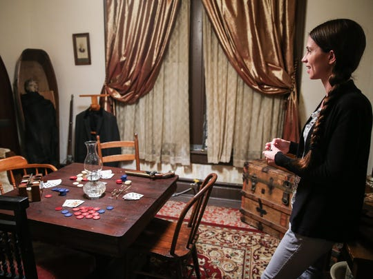 Tour guide Katie Harmon walks through the gambling room at Miss Hattie's Bordello Museum.