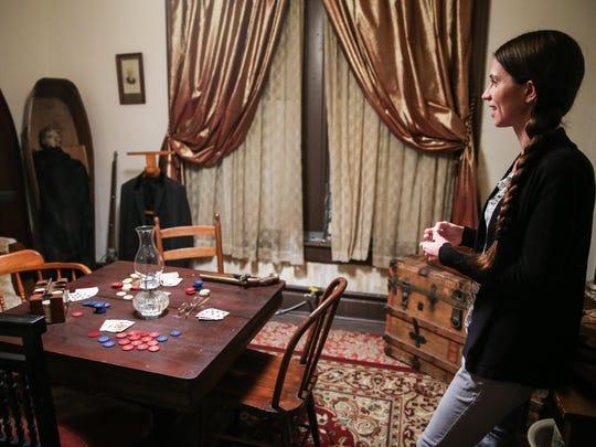 Tour guide Katie Harmon walks through the gambling