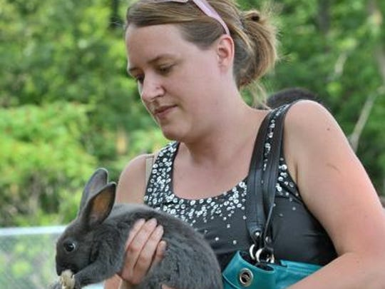 Michelle Carr, of Rothschild, holds a rabbit during