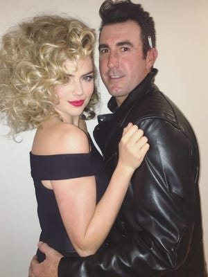 Justin Verlander, right, and Kate Upton dressed up as Sandy and Danny from the 1978 movie Grease on Halloween Monday.