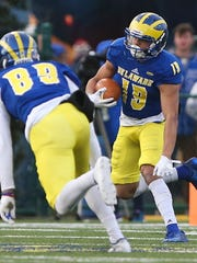 Delaware's Gene Coleman II takes a kickoff upfield in the first quarter at Delaware Stadium Saturday.
