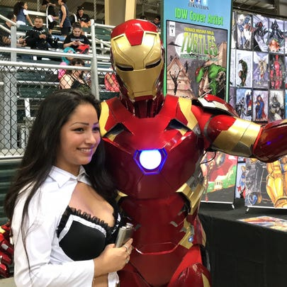 """A costume player poses with """"Iron Man"""" at the Corpus"""