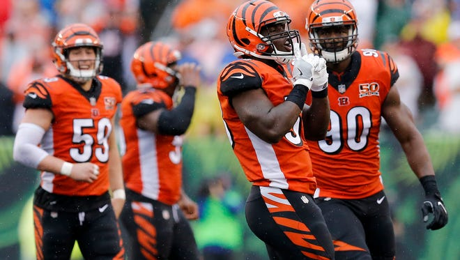 Cincinnati Bengals defensive end Carl Lawson (58) celebrates a sack in the fourth quarter of the NFL Week 5 game between the Cincinnati Bengals and the Buffalo Bills at Paul Brown Stadium in downtown Cincinnati on Sunday, Oct. 8, 2017. The Bengals won 20-16 and head into the bye week with a 2-3 record.