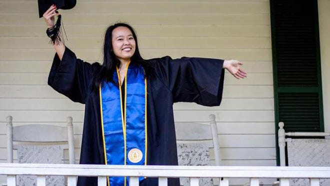 A University of North Georgia graduate celebrates on a porch. UNG will give graduates a chance to celebrate through a virtual program beginning July 27.