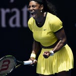 Serena Williams reacts after winning a point against Maria Sharapova during their quarterfinal match at the Australian Open on Tuesday in Melbourne, Australia. Williams won 6-4, 6-1.