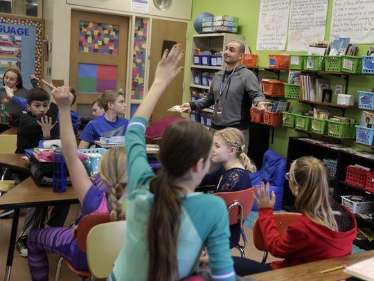 Ken Wertman, a substitute teacher, asks a question