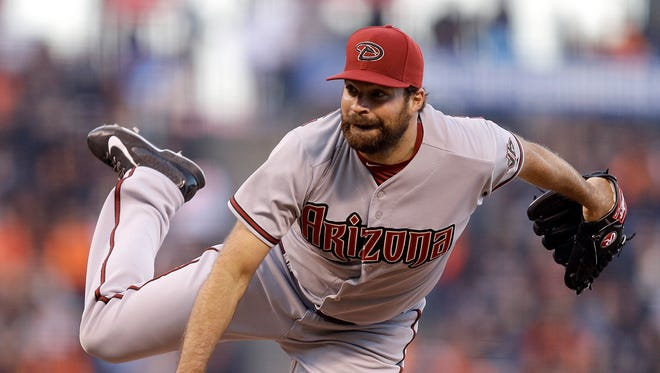 Arizona Diamondbacks' Josh Collmenter watches a pitch to the San Francisco Giants in the first inning of a baseball game Friday, April 17, 2015, in San Francisco.