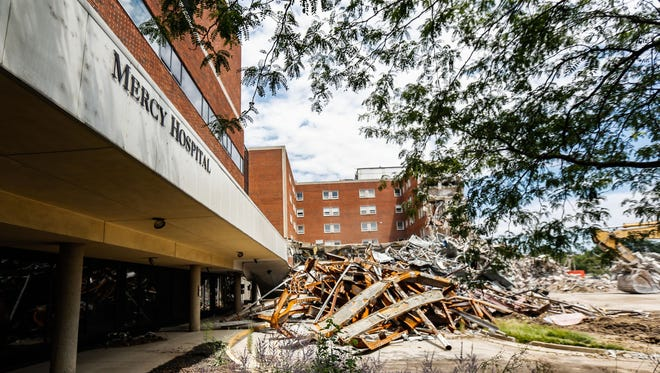 Despite efforts to sell or repurpose the building, Mercy Health has started knocking down the Mount Airy hospital on Kipling Avenue.