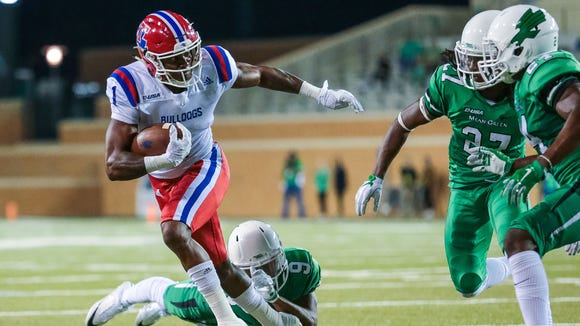 Louisiana Tech Bulldogs wide receiver Carlos Henderson (1) caries the ball in the fourth quarter against the North Texas Mean Green at Apogee Stadium. Mandatory Credit: Sean Pokorny-USA TODAY Sports