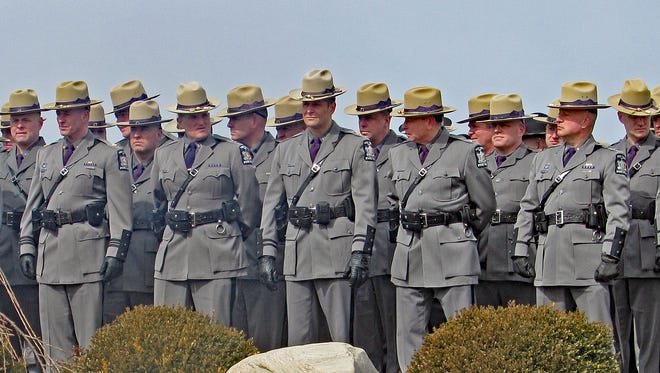 State police representatives line up Tuesday during a memorial ceremony for slain state Trooper Andrew J. Sperr.