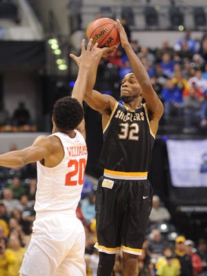 Wichita State Shockers forward Markis McDuffie (32) shoots over Dayton Flyers forward Xeyrius Williams.