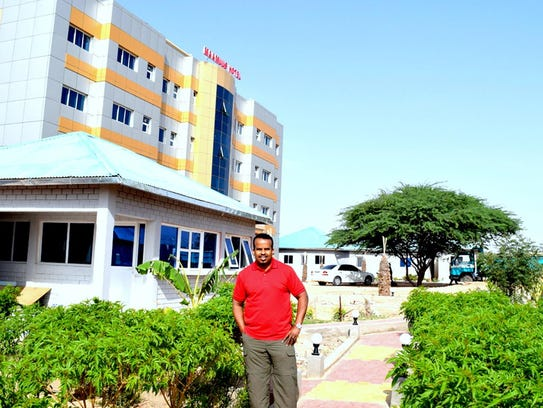 Ahmed Abdi is shown in front of Hotel Mansur in Hargaysa,