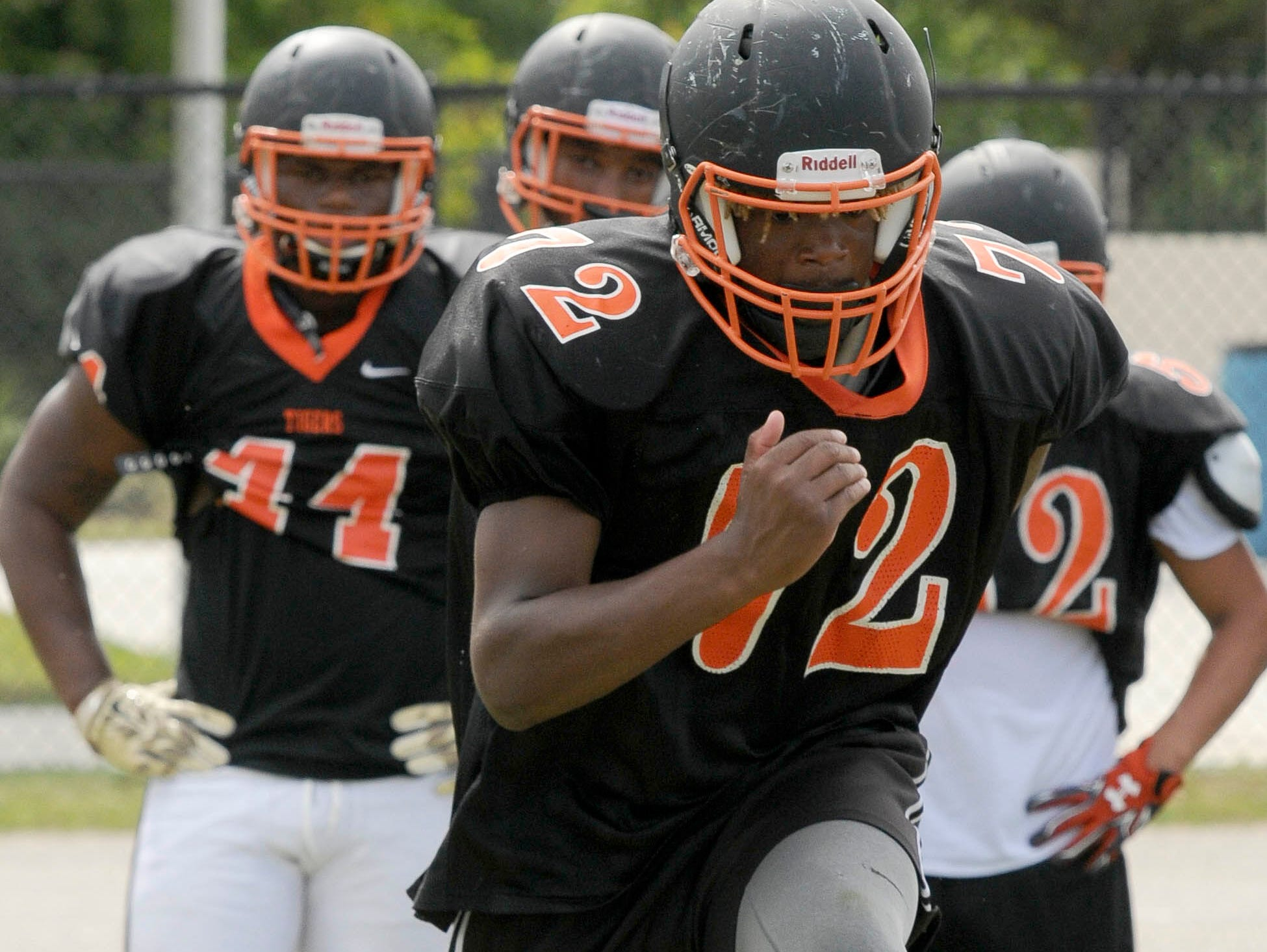 Football players at Cocoa High School work on their technique during practice.