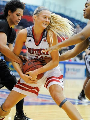 Southern Indiana Guard Kaydie Grooms (33) battles for the ball with Young Harris Meredith Tarver (23) and Young Harris guard Tamiera Mobley (5) during the University of Southern Indiana Thanksgiving Classic at USI, Saturday Nov, 26, 2016. Southern Indiana beat Young Harris 81-48.
