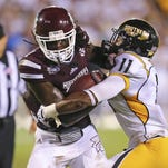 Mississippi State wide receiver De'Runnya Wilson (1) advances the ball against Southern Miss Golden Eagles defensive back Kalan Reed (11) during the game at Davis Wade Stadium.