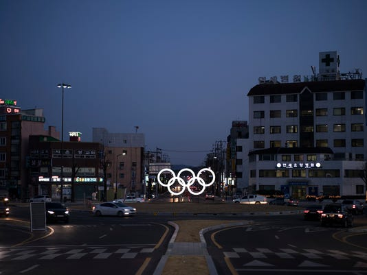 FILE - In this Feb. 3, 2018 file photo, illuminated Olympic rings shine at dusk prior to the 2018 Winter Olympics in Gangneung, South Korea. (AP Photo/Felipe Dana, File)
