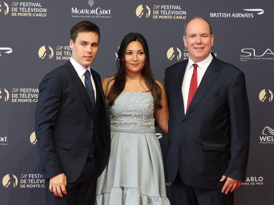 """Louis Ducruet (from left), the son of Princess Stephanie of Monaco;  his fiancee Marie Chevallier; and Prince Albert II of Monaco arrive for the screening of the film """"Jack Ryan"""" during the opening during the opening of the 58th Monte-Carlo Television Festival on June 15, 2018 in Monaco."""