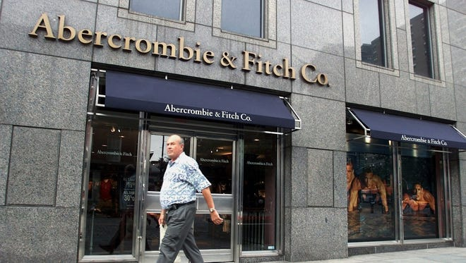 A man walks past the Abercrombie & Fitch store at the South Street Seaport in New York.