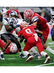 Sweetwater defensive back Kobe Clark (8) tackles West Orange-Stark running back Jeremiah Shaw (21) for a loss during the third quarter of Sweetwater's 24-6 loss in the Class 4A Div. II state championship game on Friday, Dec. 16, 2016, at AT&T Stadium in Arlington. Kentavious Miller (4)