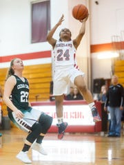 Vineland guard Nosaja Echevarria (24) takes a shot against Cedar Creek at Vineland High School on Thursday, January 12.
