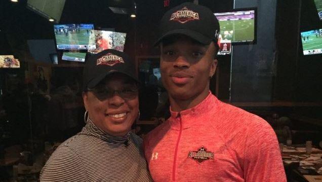 Dorian Thompson-Robinson with his mother, Melva Thompson-Robinson.