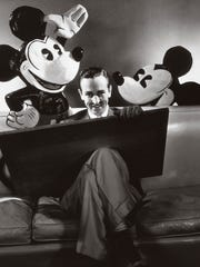 Walt Disney in October 1933 with a drawing board and