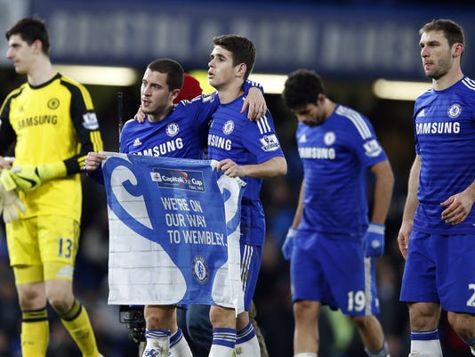 Chelsea's Thibaut Courtois, left, Eden Hazard, 2nd left, Oscar, center, Diego Costa, 2nd right, and goal scorer Branislav Ivanovic celebrate winning the English League Cup semifinal second leg soccer match between Chelsea and Liverpool at Stamford Bridge stadium in London, Tuesday, Jan. 27, 2015. (AP Photo/Alastair Grant)