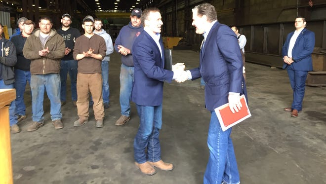 Gov. Eric Greitens shakes the hand of Drew Erdmann, Missouri's first chief operating officer, on Jan. 11 at DeLong's Inc. in Jefferson City.