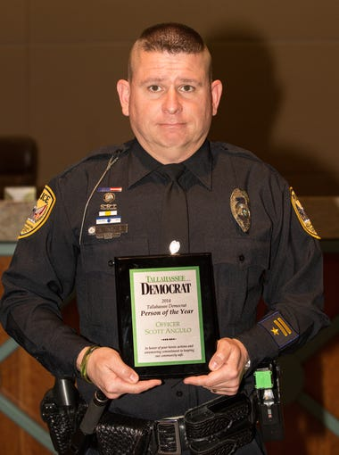 TPD Officer Scott Angulo, a 2014 Tallahassee Democrat Person of the Year award winner, poses for a picture on Wednesday, January 14, 2015, in Tallahassee, Fla.