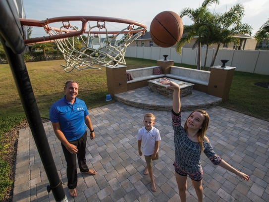 Paul Beattie plays a game of backyard basketball with