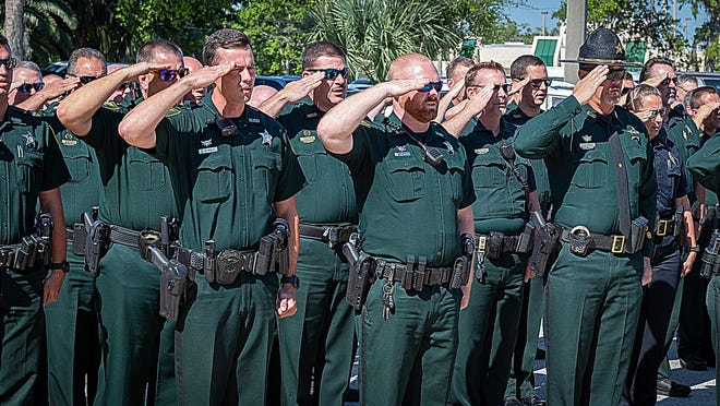 In this St. Augustine Record file photo, St. Johns County Sheriff's deputies and other area law enforcement officers salute the flag at half staff during a ceremony on Wednesday, May 15, 2019, held at the Sheriff Office's St. Augustine headquarters to remember 14 local law enforcement officers killed in the line of duty since 1911.